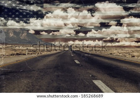 Road through the desert under the American flag  - stock photo