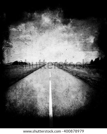 Road through the field and clouds on sky in summer day, vintage grunge textured background - stock photo