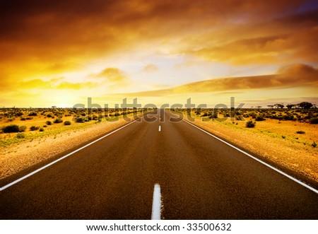Road through the middle of Australia - stock photo