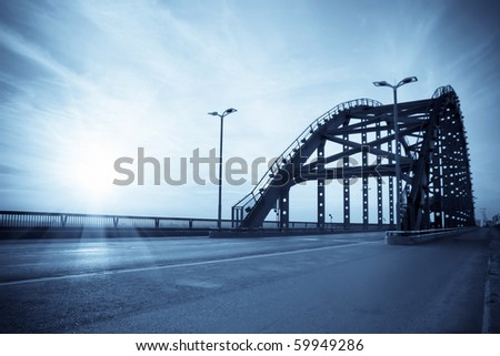 road through the modern bridge with toned in blue