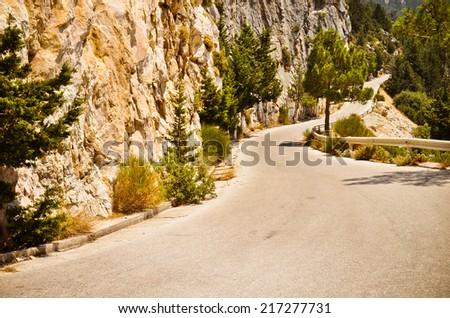 Road through the mountains of western Samos island between Drakei and Kallithea, Greece - stock photo