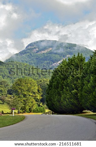 Road through the valley with Mount Yonah in the distance. - stock photo