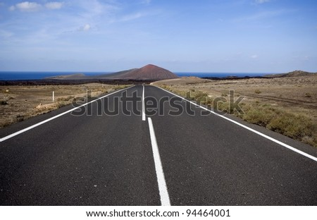 Road through volcanic area in Lanzarote, Canaries