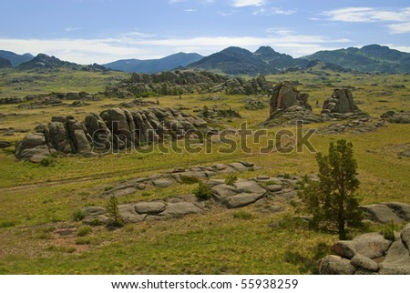 Road to a stone valley. - stock photo