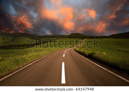 road to burning clouds. - stock photo