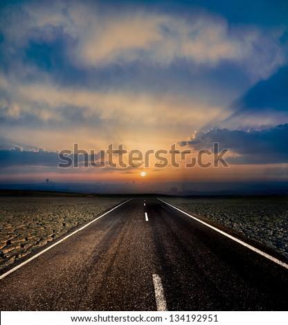 Road to city - stock photo
