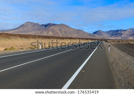 Road to Corralejo in volcanic landscape of Fuerteventura island, Canary Islands, Spain
