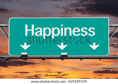 Road to happiness freeway sign with sunrise sky. - stock photo