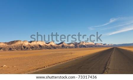Road to Infinity - Desert higway, Akakus (Acacus) Mountains, Sahara, Libya - stock photo