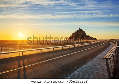 Road to Mont Saint Michel at sunset, Normandy. France. - stock photo