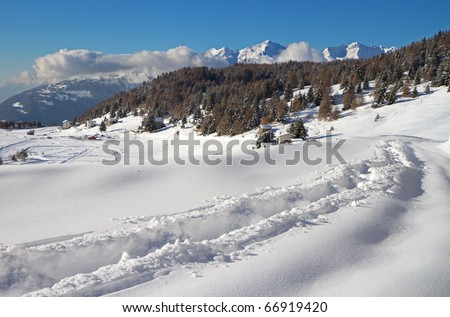 Road to Mortirolo Pass during winter. 1900 meters on the sea-level. Tarmac is under deep snow. Brixia province, Lombardy region, Italy