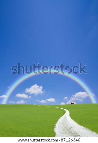 Road to red roof house with rainbow - stock photo