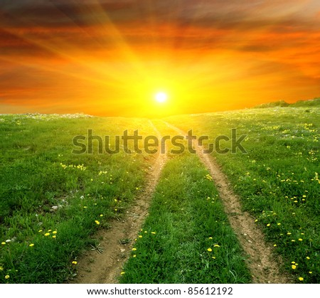 road to sunset in steppe - stock photo