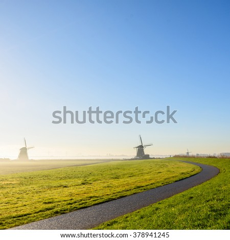 road to the Dutch windmills near Zevenhuizen in the province of South Holland, Netherlands - stock photo