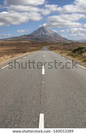 road to the Errigal mountains in county Donegal Ireland on a bright cloudy day - stock photo