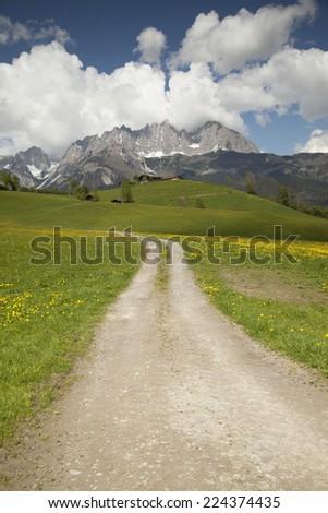 Road to the mountain range  - stock photo