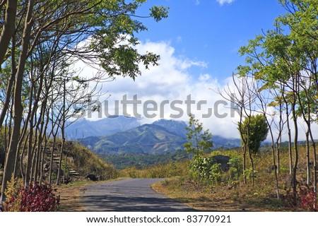 Road to the mountain village. - stock photo