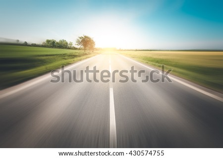 Road to the sun. Beautiful yellow field countryside landscape - stock photo