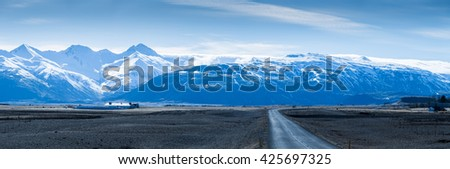 Road to winter mountains in Iceland - stock photo