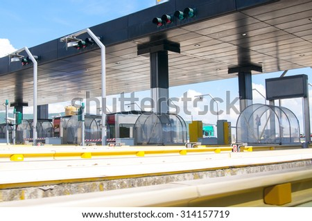 Road Toll station for using highway and motorway. Entrance of a highway toll in Italy - stock photo