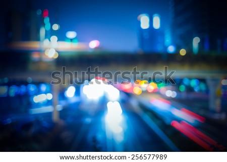 Road traffic at night - stock photo