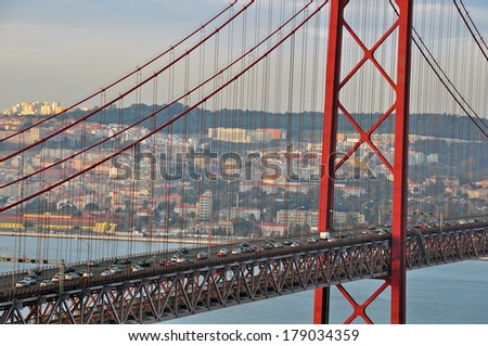 Road traffic on the bridge. Lisbon, Portugal - stock photo