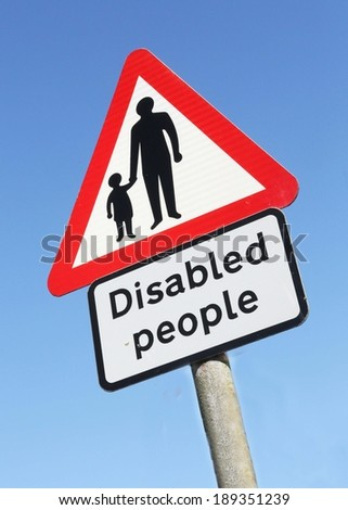 Road traffic warning sign indicating elderly and disabled people in the area
