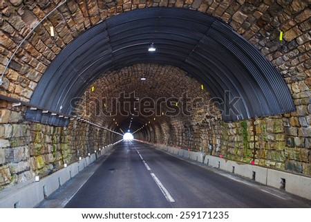 Road tunnel in alpine mountains. Hochalpenstrasse, Austria - stock photo