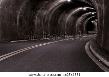 road tunnel with lights and stripes