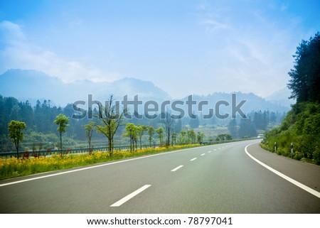 road turn through the mountain district - stock photo