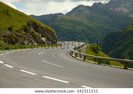 Road turning in the mountains - stock photo