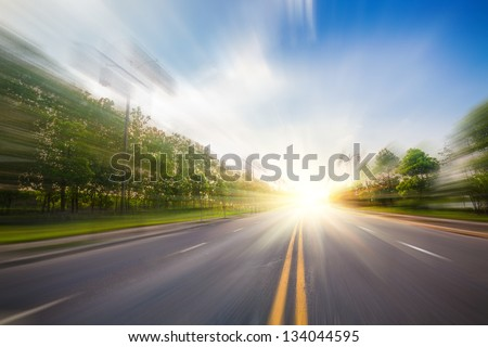 road under blue sky - stock photo