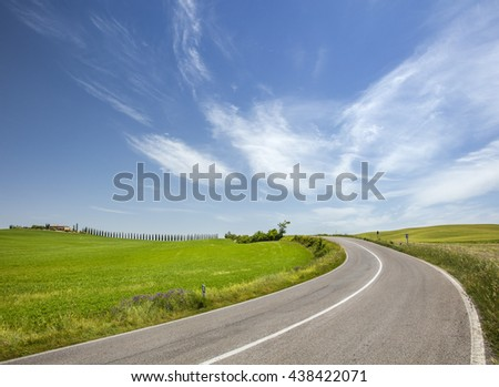 road under sky clouds in Tuscany in Italy