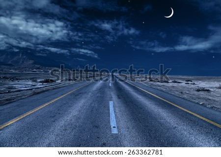 road under the moon  - stock photo