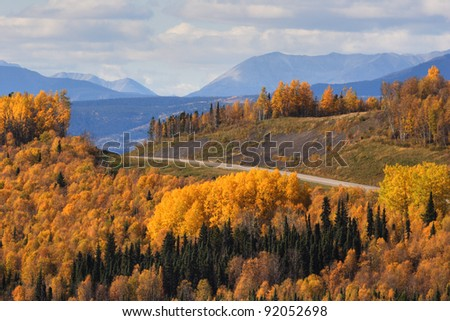 Road view of the Rocky Mountains - stock photo
