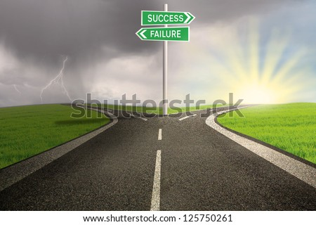 Road way to success or failure on stormy background - stock photo