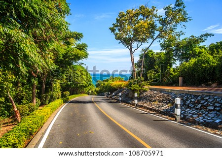 Road Way To The Beach With Blue Sky - stock photo
