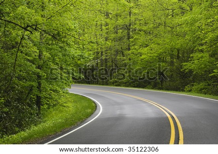 road winding around a bend - stock photo