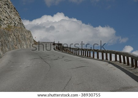 road with blue and white sky - stock photo