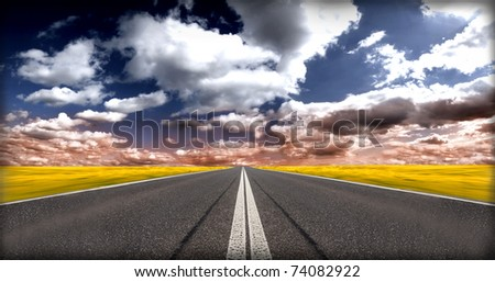 Road with cloudy sky in evening - stock photo