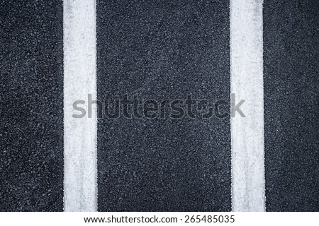 road with dividing white stripes - stock photo