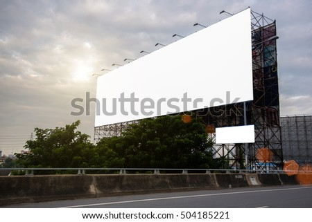Road with lanterns and large blank billboard at evening in city : Bangkok : Thailand