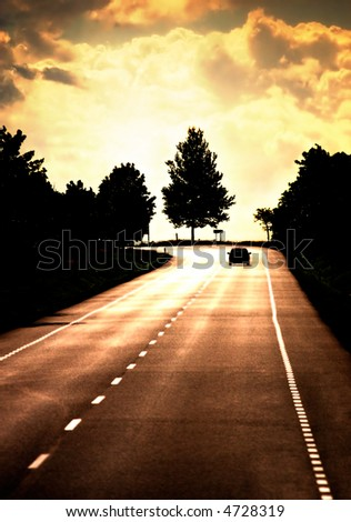 Road with lonely car. Red sunset light and high contrast. - stock photo