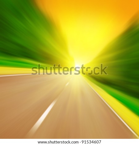 Road with motion blur at sunset. - stock photo