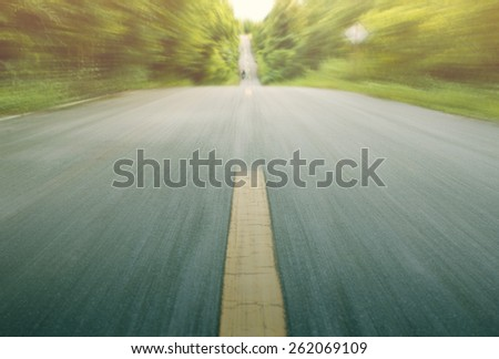 Road with motion blur in the nature - stock photo