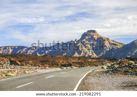 Road with mountain in sunset on Tenerife, one of the Canary Islands - stock photo