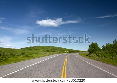 Road With Painted Double Yellow Line. Photo is taken in Alberta, Canada. - stock photo