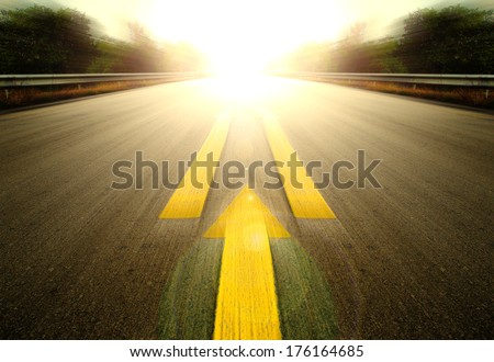 Road With Painted Yellow arrow Line. - stock photo