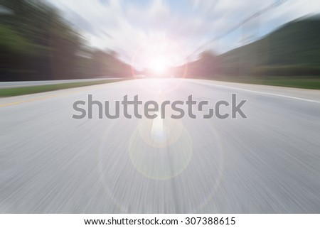 road with speed motion blur - stock photo