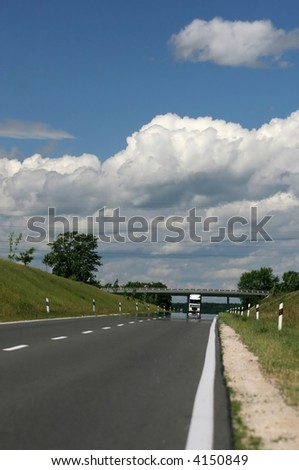 Road with truck and beautiful clouds